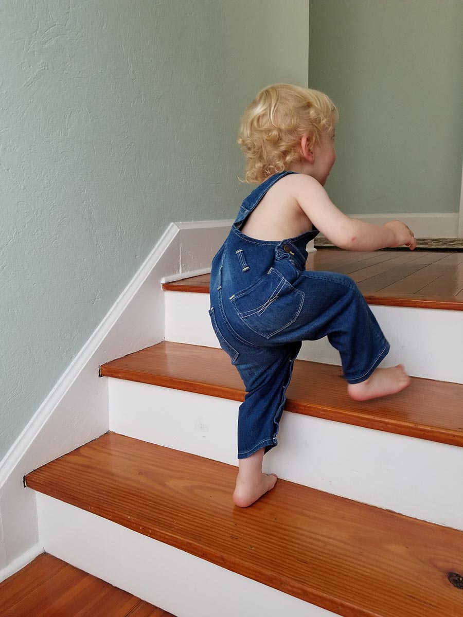Free stock photo Little boy toddler climbing stairs at home