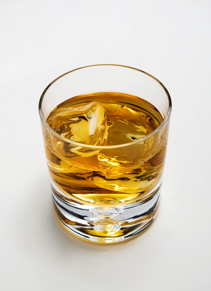 Free stock photo Looking down into a glass of whiskey with ice
