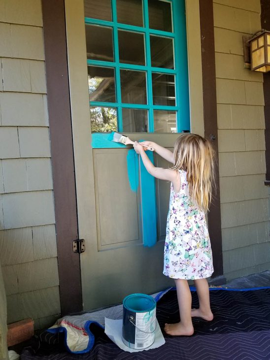 Free stock photo Little girl painting front door of her house