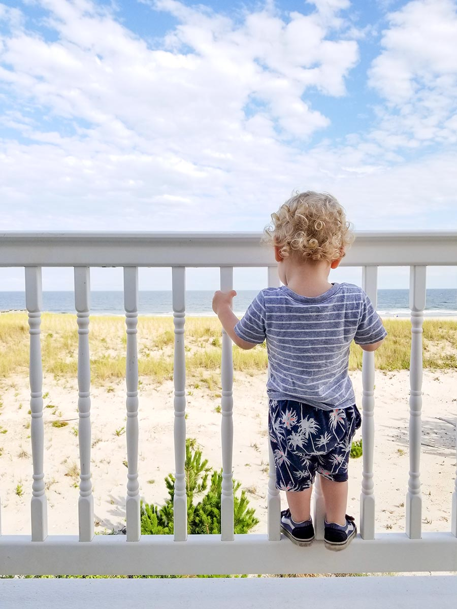 Free stock photo Little boy looking out at the seashore