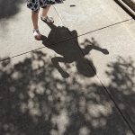 Free stock photo Shadow pattern of a child playing on a sidewalk