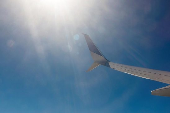 Free stock photo Airplane wing and sun flare