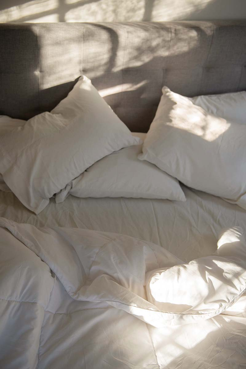 Free stock photo Unmade bed with sunlight shining on it