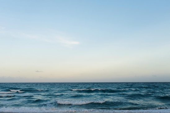 Free stock photo Ocean and horizon with a clear blue sky