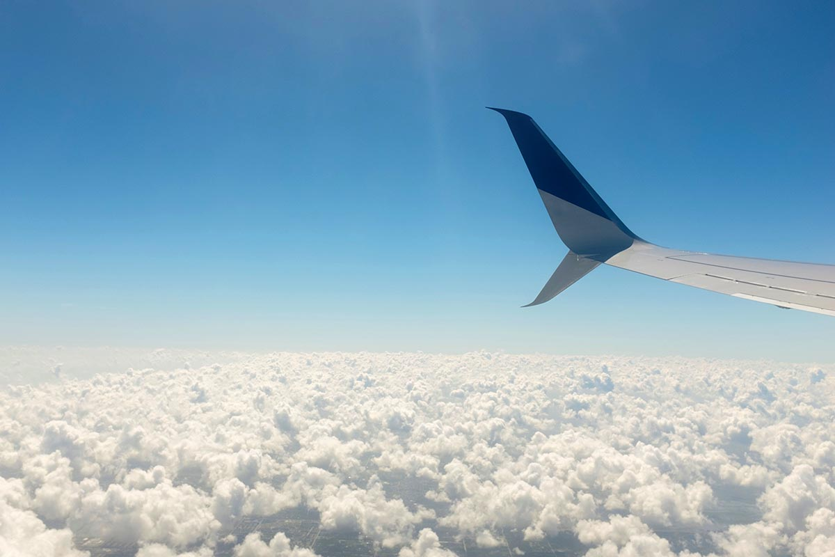 Free stock photo Airplane wing and white clouds