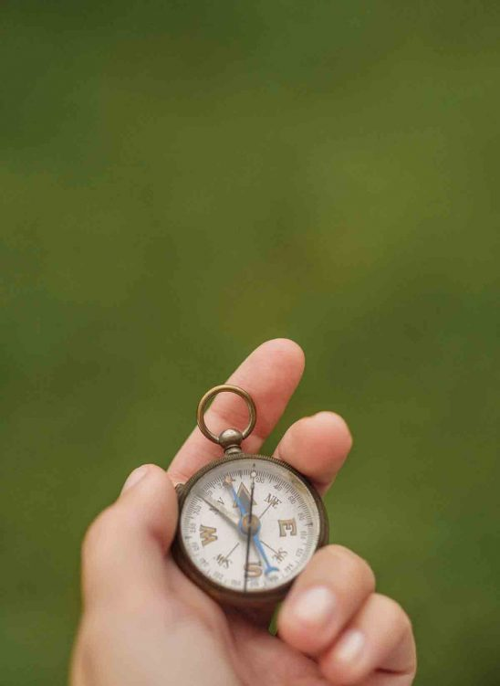 Free stock photo Close-up of hand holding compass