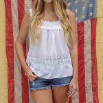 Free stock photo Midsection of smiling woman standing against american flag