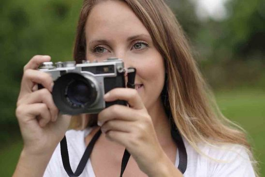 Free stock photo Close-up of woman using old-fashioned camera