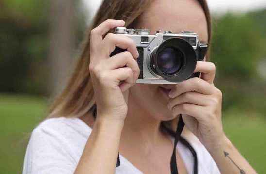 Free stock photo Close-up of woman using a vintage camera