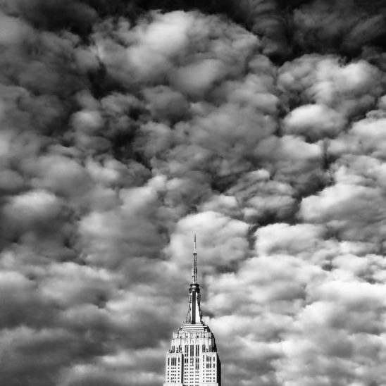 Free stock photo Buttermilk clouds and top of the Empire State Building