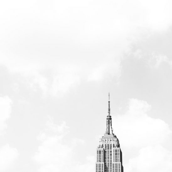Free stock photo Top of the Empire State Building against a white sky