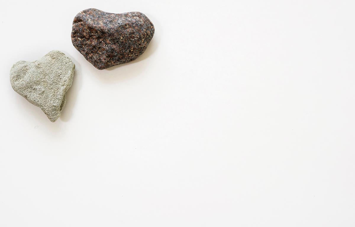 Free stock photo Two heart shaped stones against a white background