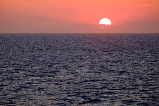 Free stock photo Sun setting on the ocean