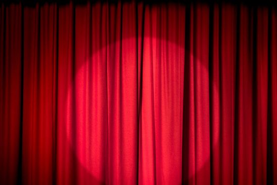 Free stock photo Red stage curtain with a spotlight