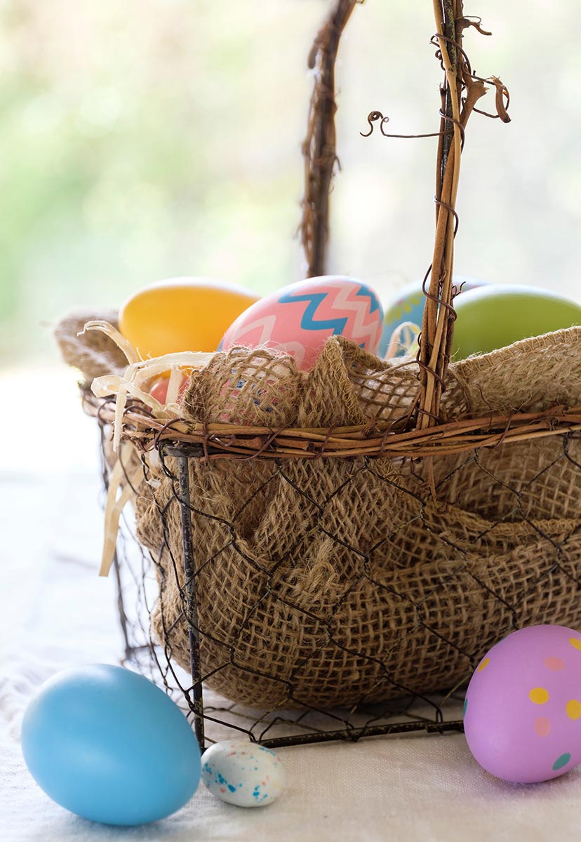 Free stock photo Colorfully decorated Easter eggs in a basket