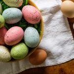 Free stock photo A bowl full of decorated Easter eggs on a table