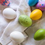 Free stock photo Decorated Easter eggs on a white table cloth