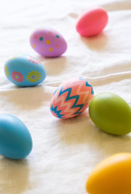 Free stock photo Colored Easter eggs on a white cloth background
