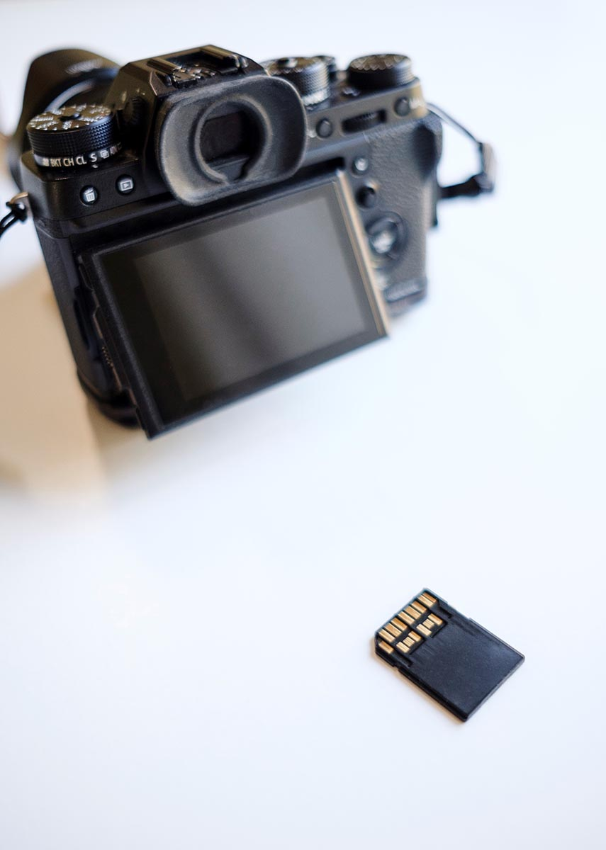 Free stock photo Memory card with digital camera on white