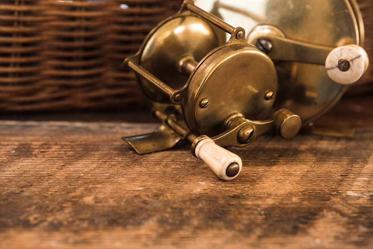 Free stock photo Close up of an old brass fishing reel