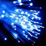 Free stock photo Close up view of blue light coming through a fiber optic cable