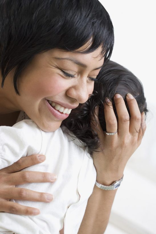 Free stock photo Mother hugging her young child