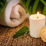 Free stock photo Spa still llife with candle; tropical leaf, and seashell