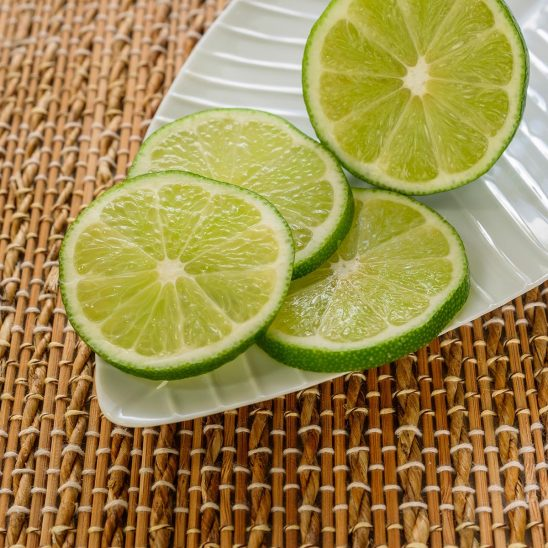 Free stock photo Slices of lime on a white plate