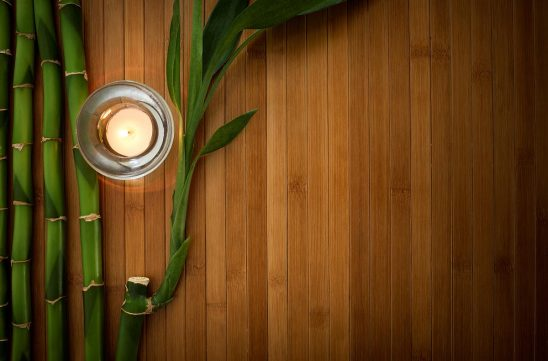 Free stock photo Bamboo stalks and candle framing background space