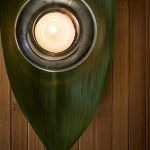 Free stock photo Candle on a tropical leaf