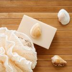 Free stock photo White soap and seashells on a tropical mat