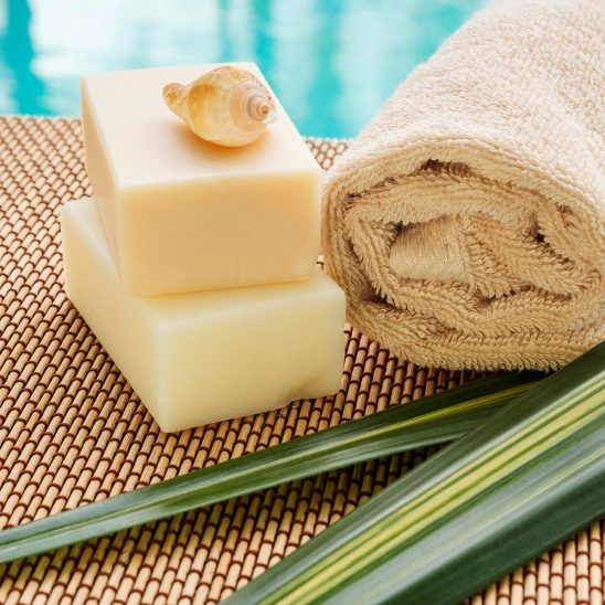Free stock photo Soaps and towel in a tropical spa scene