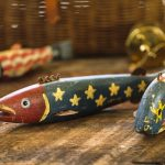 Free stock photo Group of antique fish decoys painted with American flag design