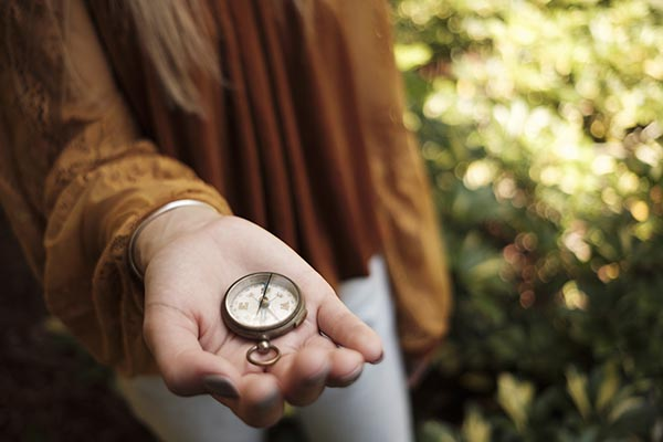 Free stock photo Woman's hand holding an antique compass