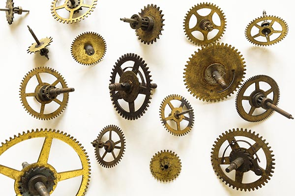 Free stock photo Assortment of clock gears on a white background