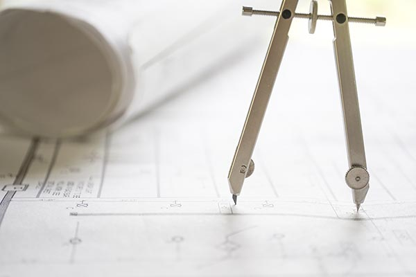 Free stock photo Drafting compass on building plans