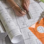 Free stock photo Woman architect drawing a line on plans