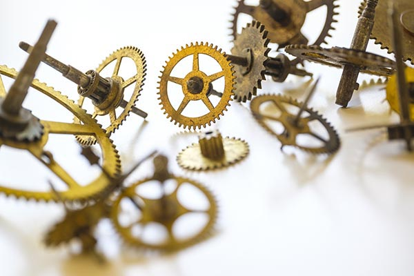 Free stock photo Gears from a clock on a white background