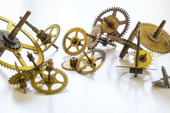 Free stock photo Group of old watch gears on a white background