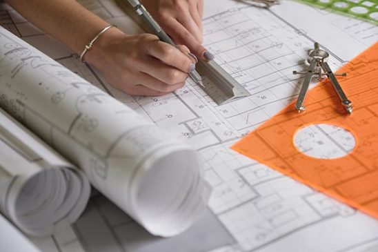 Free stock photo Woman's hands drawing on architecture plans