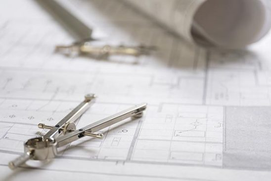 Free stock photo Drafting compass resting on architectural plans