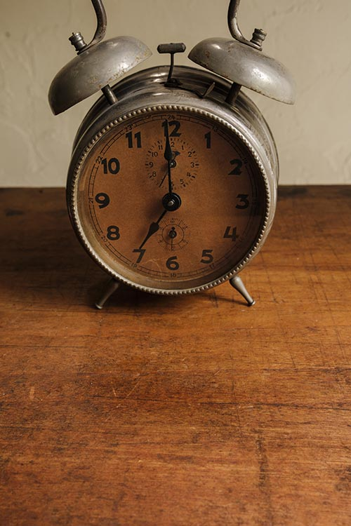 Free stock photo Retro alarm clock on a wooden table top