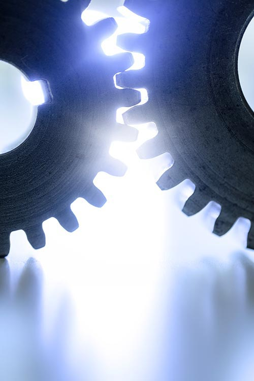 Free stock photo Bright light shining through two connected gears