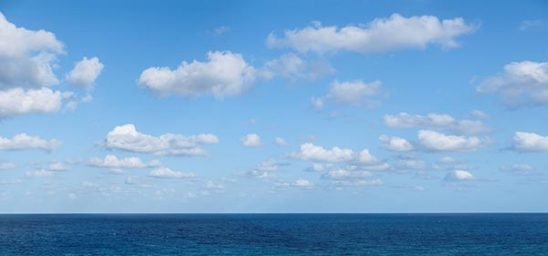 Free stock photo Atlantic Ocean with sky and clouds on a calm day