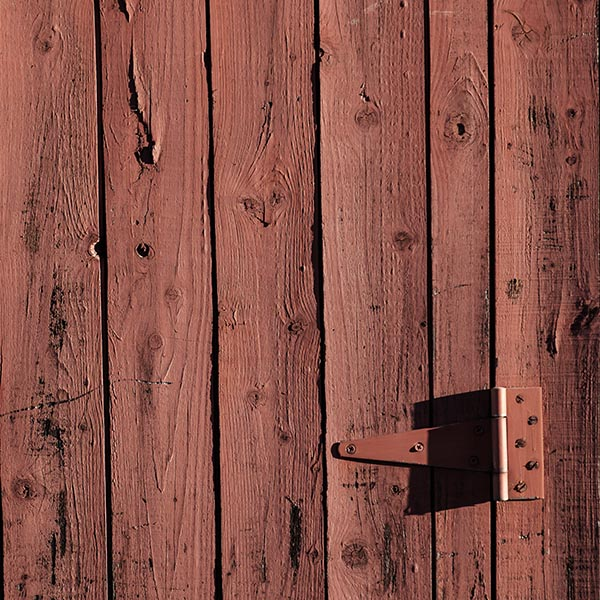 Free stock photo Full frame image of an old red barn wood door with a hinge