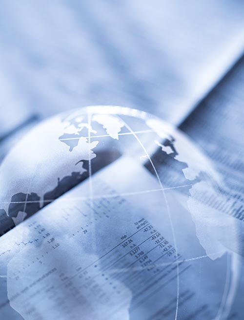 Free stock photo Outline of the world on financial papers