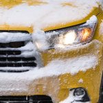 Free stock photo Full frame of a New York taxi covered in snow