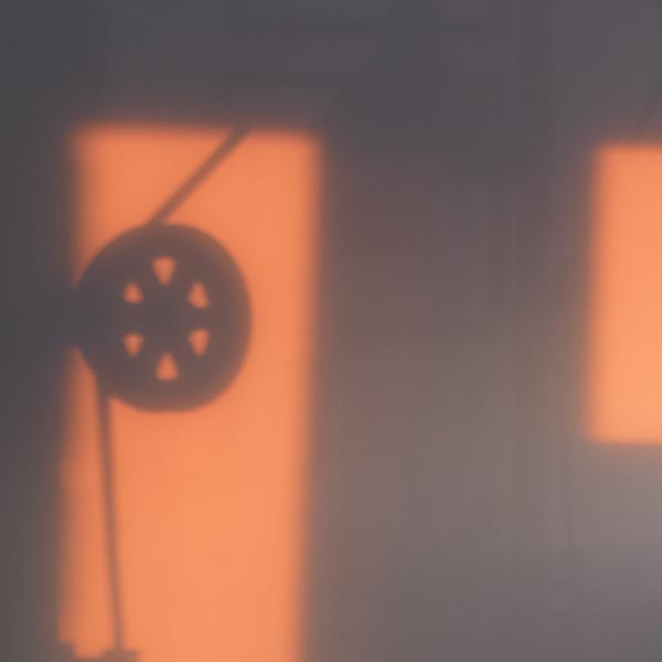 Free stock photo Shadow of an industrial pulley with sunrise light