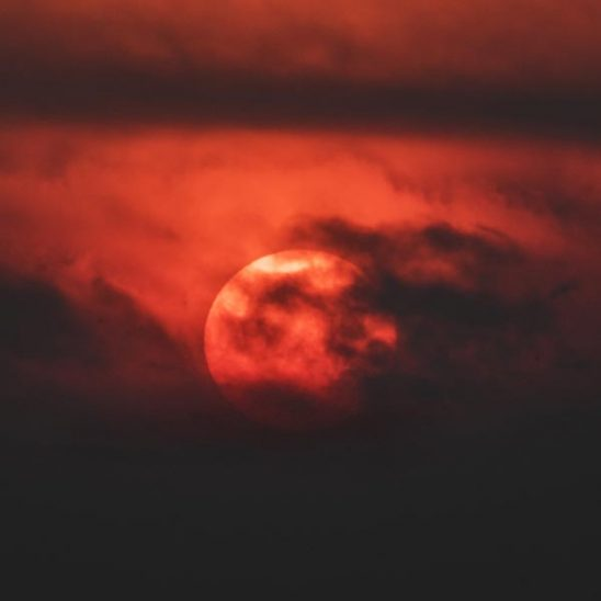 Free stock photo Close up of a red hot sun with clouds