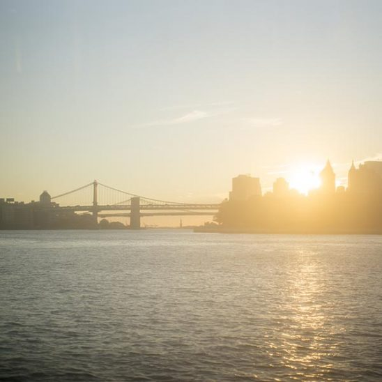 Free stock photo East River sunset with lower Manhattan and the Brooklyn Bridge